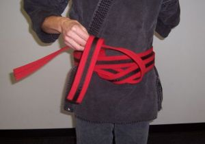 How to tie your belt step five