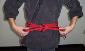 How to tie your belt step eight